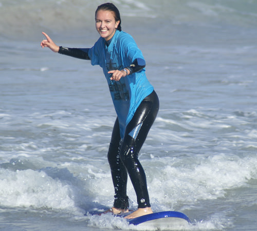 Surfing Lessons Perth girl surfing Scarborough Beach