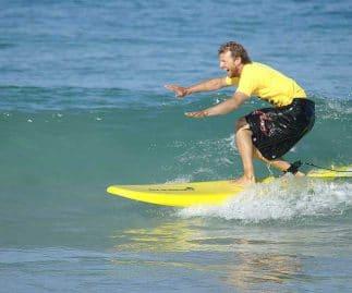 Surfing lessons Perth Jon surfing Scarborough Beach