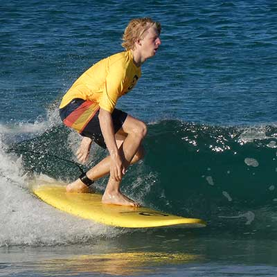 Bailey having fun during his surf lesson
